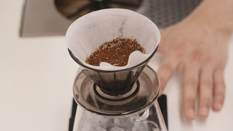 Person making a V60 pour over coffee from above