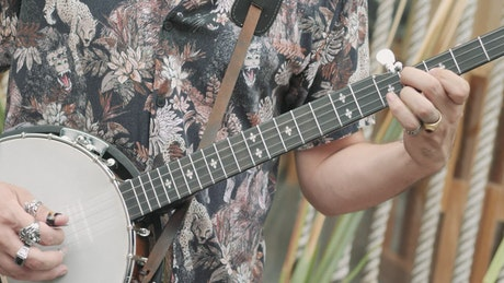 Person nimbly playing the banjo