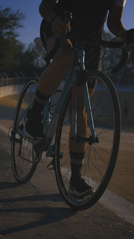 Person on a bicycle starts to ride on a cycling track