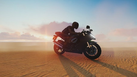 Person on a motorcycle in the middle of a desert