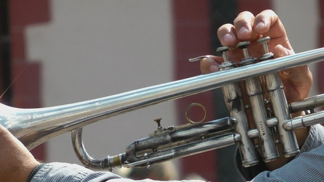 Person playing a trumpet, close up