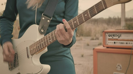 Person playing electric guitar, close up