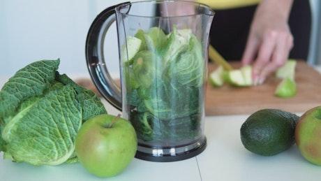 Person preparing a healthy drink