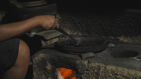 Person roasting coffee beans
