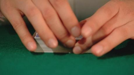 Person shuffling poker cards