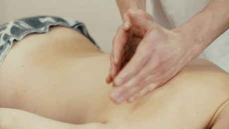 Person taking a relaxing back therapy