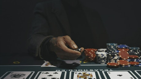 Person throwing a casino chip