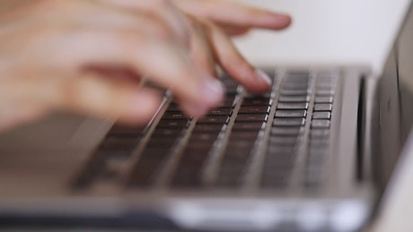 Person typing on a computer in detail