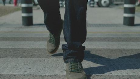 Person walking on crosswalk