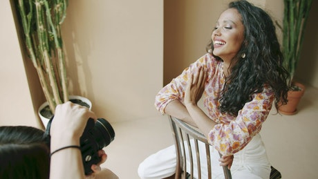 Photographer portraying a smiling model