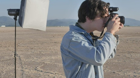 Photographer taking photos in the middle of a desert