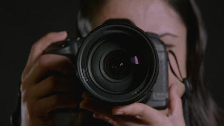 Photographer using a digital camera