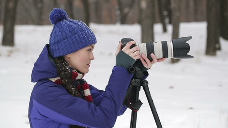 Photographer working in nature in winter