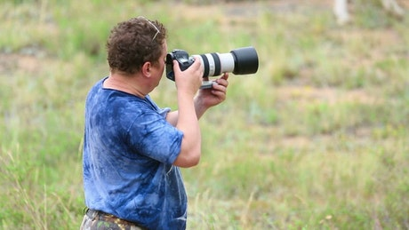 Photographer working in the field