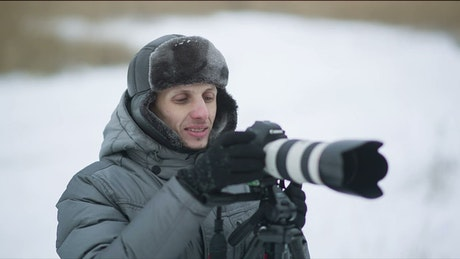 Photographer working on an outdoor winter spot