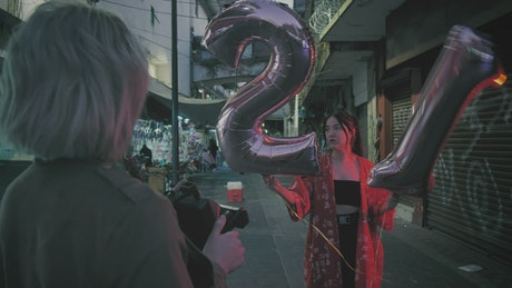 Photographing a girl with numbered balloons