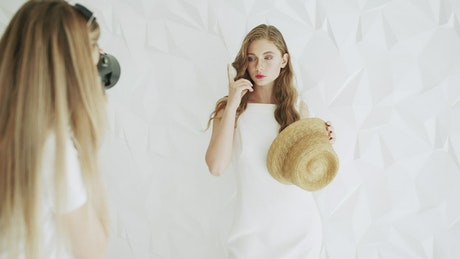 Photoshoot of a model in a white dress