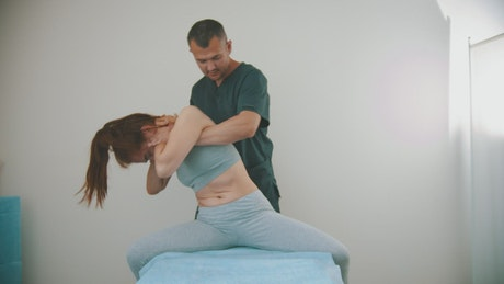 Physiotherapist working on a woman's neck