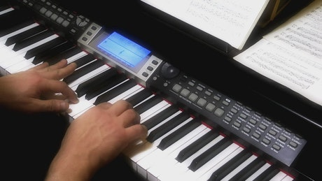 Pianist hands playing the piano