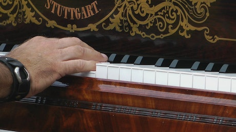 Pianist playing a song, static shot