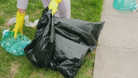 Picking up plastic garbage