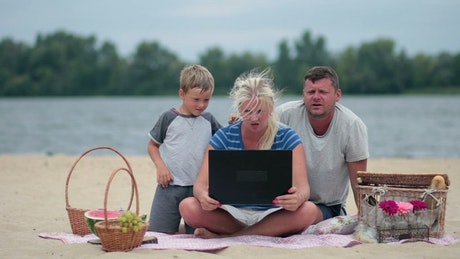 Picnic at the beach with a laptop
