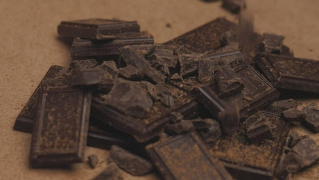 Pile of pieces of chocolate bars falling down