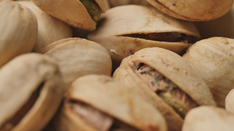 Pile of pistachios in their shell in a very detailed shot