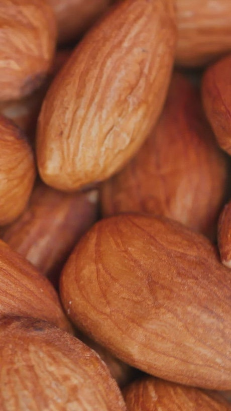 Piled almonds rotating detailed views