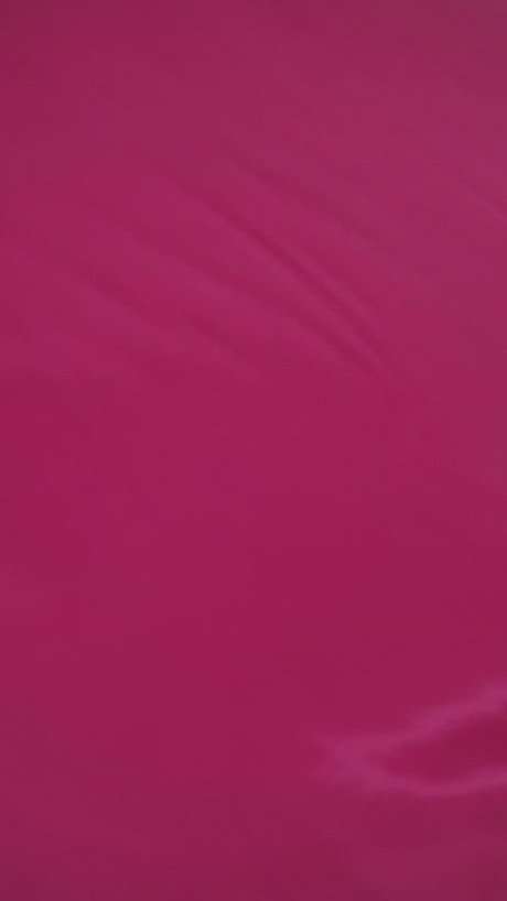 Pink fabric moving, background texture