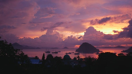 Pink sunset on a tropical landscape
