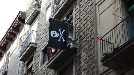 Pirate flag hanging from a balcony