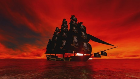 Pirate ship sailing in a red sunset