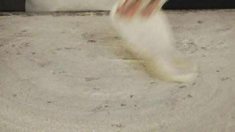 Pizza maker preparing dough