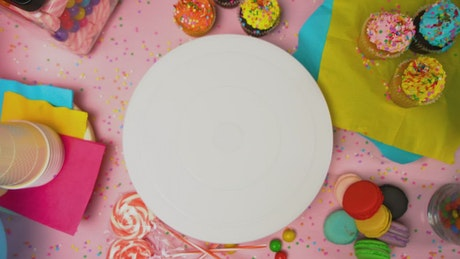 Placing a cake in the center of a party table