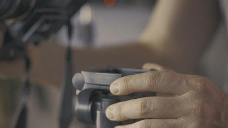 Placing a camera on a tripod