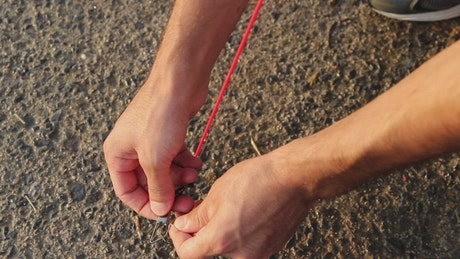Placing a fastener with a rope on the floor