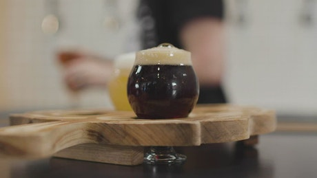 Placing beers on a wooden board