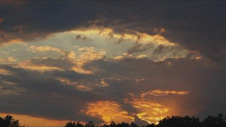 Plane flying across the sky at sunset
