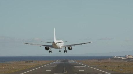 Plane landing at a coastal airport