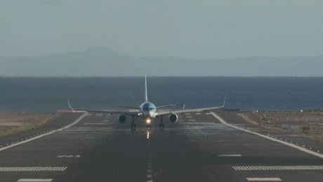 Plane leaving an island