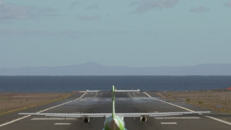 Plane preparing to take off from an island