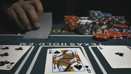 Player throwing his poker cards