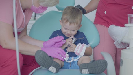 Playful boy in consultation with the dentist