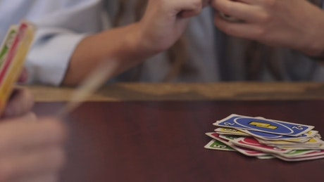 Playing a game of UNO with friends