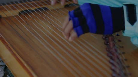 Playing a Harp with gloves