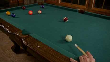 Playing a round of Billiards