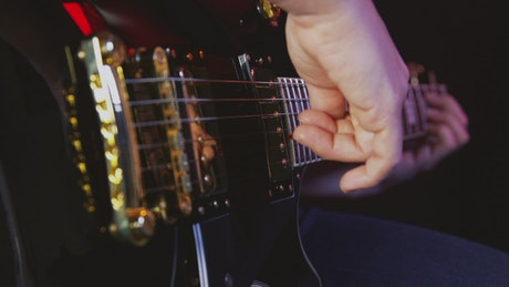 Playing an electric guitar in store