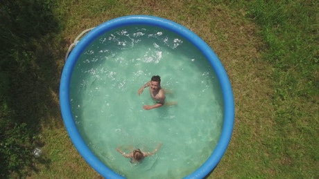 Playing in an inflatable pool