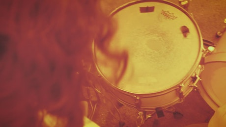 Playing the drums on a sepia filter